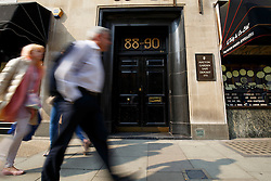 © Licensed to London News Pictures. 08/04/2015. LONDON, UK. People walk past Hatton Garden Safety Deposit Ltd whilst detectives and scenes of crime officers carrying out a forensic examination at Hatton Garden Safety Deposit Ltd in London on Wednesday, 8 April 2015. Police believes that approximately 60 - 70 safety deposit boxes were opened during the burglary over Easter weekend. Photo credit : Tolga Akmen/LNP