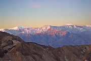 Sunrise over the Panamint Mountains as viewed from Zabriskie Point.Death Valley National Park, California