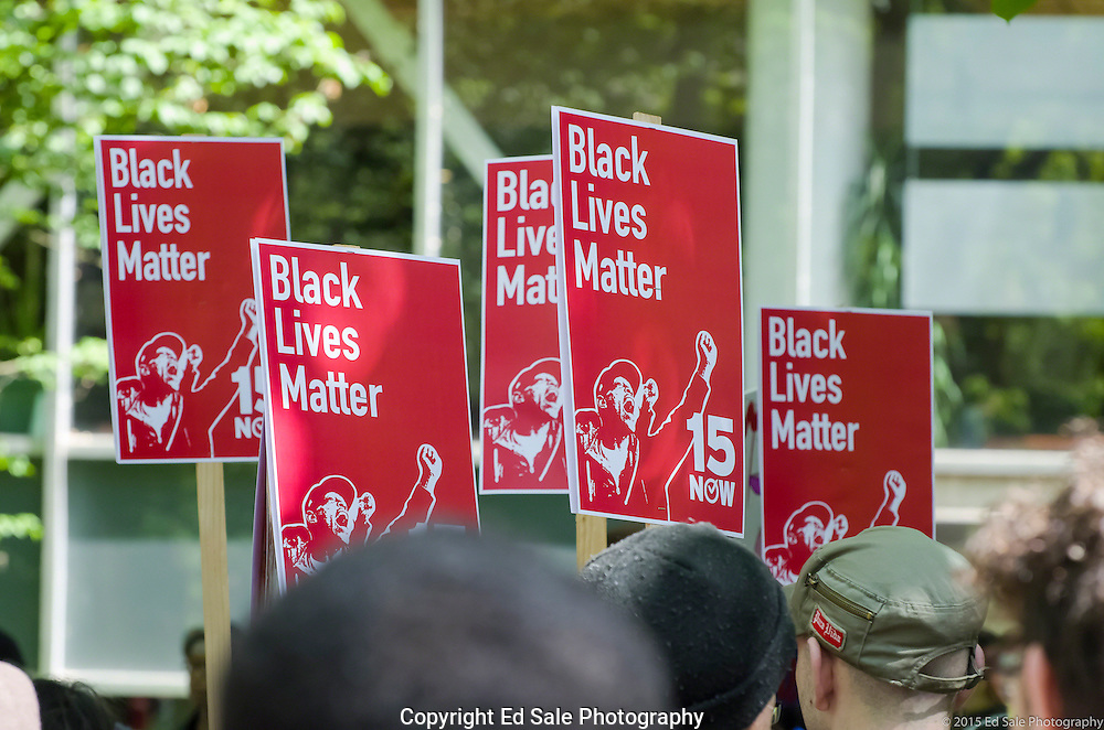 Sings held by protestors at the 2105 May Day Rally in Portland, Oregon say Black Lives Matter.