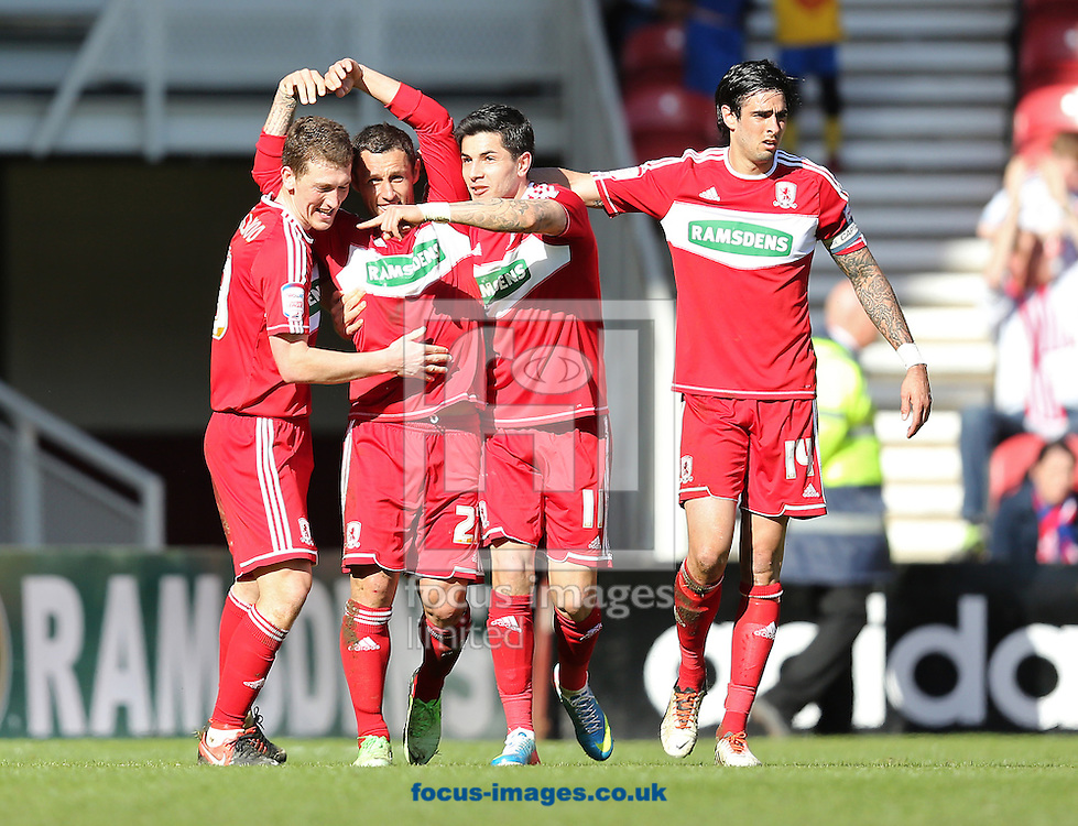 Picture by Paul Gaythorpe/Focus Images Ltd +447771 871632.27/04/2013.Middlesbrough players congratulate Scott McDonald on scoring a late equaliser against Charlton Athletic during the npower Championship match at the Riverside Stadium, Middlesbrough.