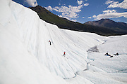 Clients try out ice climbing on a daytrip with St. Elias Alpine Guides to the Root Glacier in Wrangell-St. Elias National Park, Alaska.