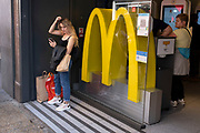 People outside McDonalds on Oxford Street on 10th August 2021 in London, United Kingdom. McDonalds is an American fast food company, founded in 1940, with the Golden Arches logo being introduced in 1953.