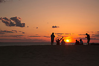 NC01432-00...NORTH CAROLINA - Watching the sunset over Roanoke Sound from a tall sand dune, a popular activity at Jockey's Ridge State Park on the Outer Banks at Nags Head.