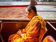 13 FEBRUARY 2014 - BANGKOK, THAILAND: A Buddhist monk naps on the Chao Phraya Express Boat on the Chao Phraya River in Bangkok.     PHOTO BY JACK KURTZ