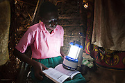 Saumu from Mari Mani primary school has a solar light supplied by Wema in her house, that she uses it to study.