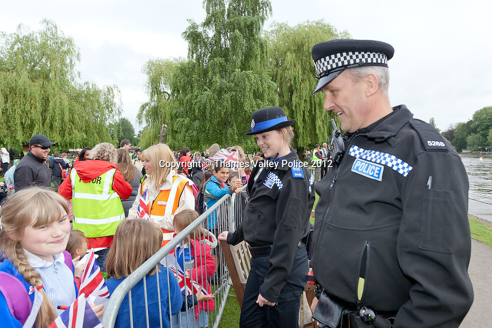 Henley, UNITED KINGDOM. July 10 2012.The Olympic Torch is rowed along the River Thames by Sir Steve Redgrave. Henley , Oxon.<br /> Photo Credit: Mark Chappell/TVP<br /> © Thames Valley Police 2012. All Rights Reserved. See instructions.