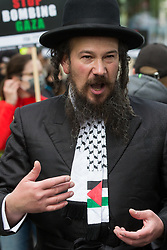 London, UK. 22nd May, 2021. An ultra-Orthodox anti-Zionist Haredi Jew from Neturei Karta UK wears a Palestinian scarf during the National Demonstration for Palestine. It was organised by pro-Palestinian solidarity groups in protest against Israel's recent attacks on Gaza, its incursions at the Al-Aqsa mosque and its attempts to forcibly displace Palestinian families from the Sheikh Jarrah neighbourhood of East Jerusalem.