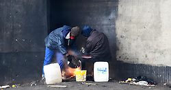 SOUTH AFRICA  - Cape Town - 28 May 2020 - Two homeless man sitting around fire and boiling water in the Culemborg area ,for the past 3 days the Western Cape has been having a bad weather .photograph;Phando Jikelo/African News Agency(ANA)