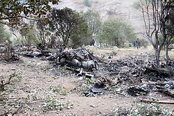 Turkish military personnel stand next to the wreckage of an helicopter after it crashed on June 1, 2017, in the southeastern city of Sirnak. Thirteen Turkish soldiers were killed on May 31, 2017 when a military helicopter crashed after hitting a high-voltage power line in the southeast of the country, the army said. The AS532 Cougar helicopter crashed shortly after taking off from a base in Sirnak province bordering Iraq, killing all 13 onboard, it said in a statement. Photo by Sekvan Kuden/Dha/Depo Photos/ABACAPRESS.COM