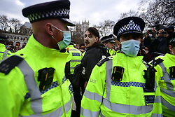 © Licensed to London News Pictures. 03/04/2021. London, UK. Police detain a Protesters in Parliament Sqsure during a Kill The Bill demonstration in central London. A number of campaign groups, including Sisters Uncut and Extinction Rebellion, have come together to form a 'Kill the Bill Coalition', which opposes the introduction of the Police, Crime, Sentencing and Courts Bill. Photo credit: Ben Cawthra/LNP