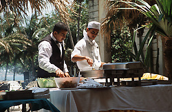 Chef and waiter working behind barbecue at the Hotel Nacional; Havana; Cuba,