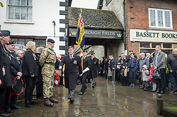 Royal British Legion standard bearers march to<br /> the war memorial during a service of remembrance at Royal Wootton Bassett, Wiltshire.