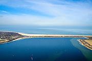 Nederland, Zeeland, Gemeente Veere, 01-04-2016; Vrouwenpolder, Veesre Meer met zicht op Veerse Gatdam. Dam waarmee het Veerse Gat is gesloten, een van de Deltawerken. Tussen Walcheren en Noord-Beveland.<br /> Veerse gat dam, one of the Deltaworks. <br />  <br /> luchtfoto (toeslag op standard tarieven);<br /> aerial photo (additional fee required);<br /> copyright foto/photo Siebe Swart