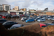 Car par or parking lot near the River Rea in Digbeth on 13th Febuary 2020 in Birmingham, United Kingdom. In the city, vehicle use is still very night and traffic congestion is an issue, due to limited transport options.