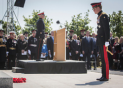 © Licensed to London News Pictures. 10/06/2015. Alrewas, UK. His Royal Highness Prince Harry of Wales and lays a wreath at a Service of Dedication to inaugurate the Bastion Memorial, for those who lost their lives during combat operations in Afghanistan.  Over 2000 guests attended the ceremony.   Photo credit : Alison Baskerville/LNP