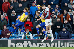 Burnley's Peter Crouch (right) directs a header on goal during the Premier League match at Turf Moor, Burnley.