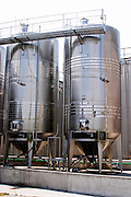 Outside stainless steel fermentation tanks with special design from Italy to allow for the removal of the grape pips after an initial cold maceration and before the main fermentation. Vinarija Citluk winery in Citluk near Mostar, part of Hercegovina Vino, Mostar. Federation Bosne i Hercegovine. Bosnia Herzegovina, Europe.