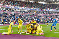 Football - 2021 / 2022  Premier League - West Ham United vs Brentford - The London Stadium - Sunday 3rd October 2021<br /> <br /> Yoane Wissa of Brentford (hidden) celebrates scoring his side's second goal in injury time to win the game 2-1.<br /> <br /> COLORSPORT/Ashley Western