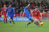 AFC Wimbledon striker Lyle Taylor (33) tackling Walsall defender Joe Edwards (2) during the EFL Sky Bet League 1 match between AFC Wimbledon and Walsall at the Cherry Red Records Stadium, Kingston, England on 25 February 2017. Photo by Matthew Redman.