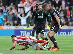 Liverpool's Jordan Henderson fouls Stoke City's Erik Pieters- Photo mandatory by-line: Nizaam Jones/JMP - Mobile: 07966 386802 - 24/05/2015 - SPORT - Football - Stoke - Britannia Stadium - Stoke City v Liverpool - Barclays Premier League