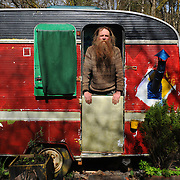 The Faslane Peace Camp near Helensburgh will soon close if there are not more volunteers living there. It has been there for 30 years.  Gwilym (55) in his caravan. Picture Robert Perry Scotland on Sunday 26th April 2013