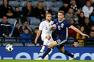 Scotland midfielder Kevin McDonald (15) (Fulham)  and Portugal defender Kevin Rodrigues (5) (Real Sociedad)  during the Friendly international match between Scotland and Portugal at Hampden Park, Glasgow, United Kingdom on 14 October 2018.