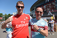two Arsenal and West Ham fans outside Emirates Stadium before k/o. Barclays Premier League, Arsenal v West Ham Utd at the Emirates Stadium in London on Sunday 9th August 2015.<br /> pic by John Patrick Fletcher, Andrew Orchard sports photography.