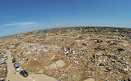 Not a single home is standing in the path of the May 20, 2013 tornado in Oklahoma City, Oklahoma May 22, 2013.  Rescue workers with sniffer dogs picked through the ruins on Wednesday to ensure no survivors remained buried after a deadly tornado left thousands homeless and trying to salvage what was left of their belongings. Curvature of horizon in the photo is due to an ultra-wide angle lens.  REUTERS/Rick Wilking (UNITED STATES)