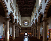Interior Wilton Italianate church, Wiltshire, England, UK nave and round window above entrance built 1844