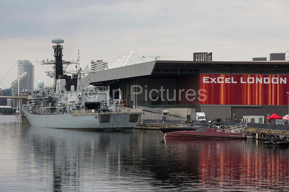 HMS Argyll, the longest-serving Type 23 Frigate in the Royal Navy, is pictured moored alongside ExCeL London in advance of the DSEI 2021 arms fair on 12th September 2021 in London, United Kingdom. Activists from a range of different groups continue to protest outside the venue for one of the worlds largest arms fairs.