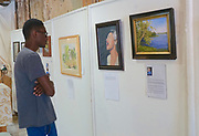 High school art student views plein aire art show, West Reading, Berks Co., PA