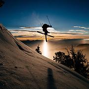 Teton Brown grabs air as the sun rises over the Teton backcountry.