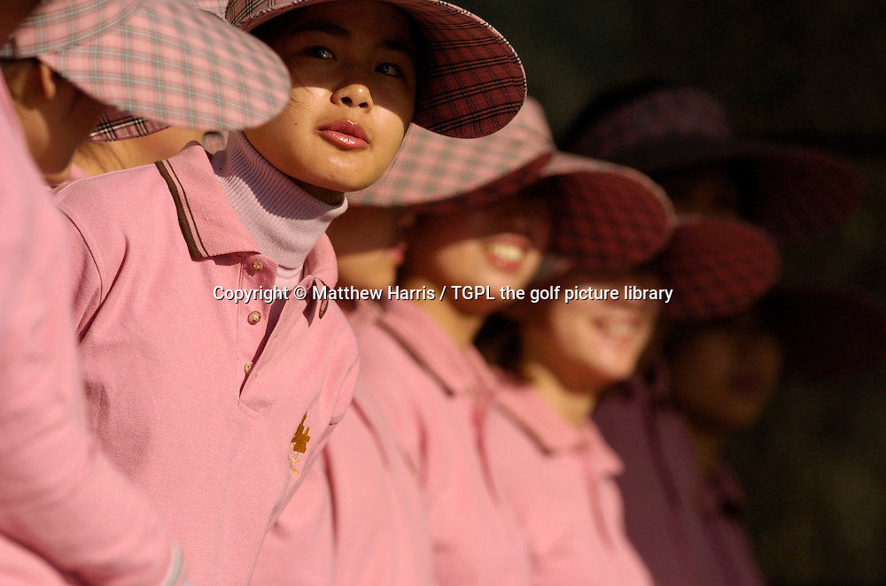 Female Chinese caddies line up for morning inspection during Johnnie Walker Asian Classic 2005, Pine Valley Golf Resort & Country Club, Changping District, Beijing, China.