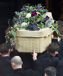 © London News Pictures. 13/02/2014. London, UK. Triggers hat on the back of the coffin entering the church..  The funeral of actor Roger Lloyd-Pack at St Pauls Church also known as 'The Actor's Church'  in Covent Garden, London. Roger Lloyd-Pack was famous for playing roles such as Trigger in Only Fools and Horses and Owen Newitt in the The Vicar of Dibley. Photo credit : Ben Cawthra/LNP