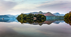 © Licensed to London News Pictures. 15/09/2020. Keswick UK. Derwent Isle reflects into the still water of Derwentwater in Keswick, Cumbria at first light this morning. Photo credit: Andrew McCaren/LNP