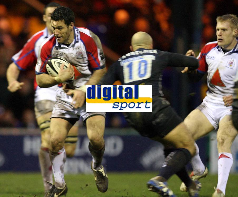 Photo: Rich Eaton.<br /> <br /> Sale Sharks v Bristol Rugby. Guinness Premiership. 01/01/2007. David Hill of Bristol left tries to get past #10 Daniel Larrechea of Sale