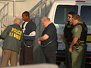 Boy-band mogul Lou Pearlman, promoter of bands such as the Backstreet Boys and 'NSYNC, is taken into the Federal Courthouse in Orlando, Fla., after his arrest for defrauding investors and banks of more than $300 million.