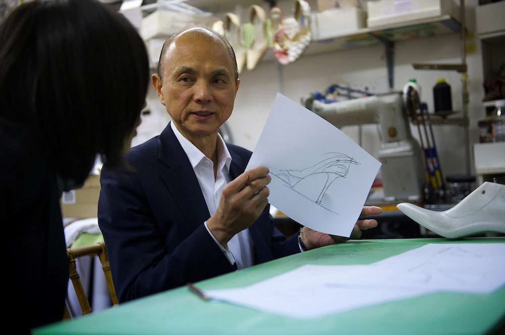 Fashion designer Jimmy Choo shows drawings in his studio on Cannaught Street, London, March 22, 2010.