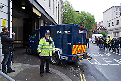 © London News Pictures. 30/05/2013. London, UK.  A high security police van carrying Michael Adebowale arriving at Westminster magistrates court in London. Michael Adebowale as been charged with the murder of soldier Lee Rigby in south-east London last week. A second man accused of murder, Michael Adebolajo, remains under arrest at a London hospital. Photo credit: Ben Cawthra/LNP