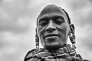 A black and white portrait of a Moran warrior of the Maasai tribe, ,Amboseli, Kenya, Africa