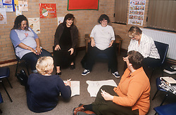 Group of pregnant women taking part in antenatal class,