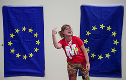 © Licensed to London News Pictures . 27/09/2017. Brighton, UK. A Momentum party member singing in front of EU flags on day 4 of the 2017 the Labour Party Conference, held at The Brighton Centre in East Sussex. Photo credit: Ben Cawthra/LNP