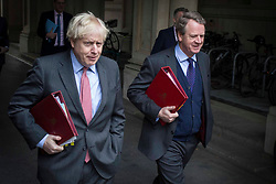 © Licensed to London News Pictures. 08/12/2020. London, UK.Prime Minister Boris Johnson (L) and Alister Jack Secretary of state for Scotland walk back into Downing Street, after attending a cabinet meeting. Prime Minister Boris Johnson witnessed coronavirus vaccinations being given this morning as the biggest immunisation campaign in UK history begins. Photo credit: Marcin Nowak/LNP