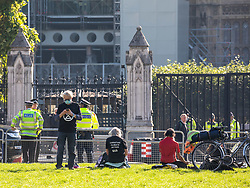© Licensed to London News Pictures. 01/09/2020. London, UK. Members of Extinction Rebellion (XR) environmental campaign group gather in Parliament Square in central London with banners and flags as they start their sit-in this morning to blockade Parliament. XR plan to peacefully disrupt the UK Parliament with actions planned over two weeks, until MP's back the Climate Ecological Emergency Bill and prepare for crisis with a National Citizens's Assembly. Photo credit: Alex Lentati/LNP