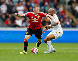 Bastian Schweinsteiger of Manchester United is tackled by Andre Ayew of Swansea City - Mandatory byline: Rogan Thomson/JMP - 07966 386802 - 30/08/2015 - FOOTBALL - Liberty Stadium - Swansea, Wales - Swansea City v Manchester United - Barclays Premier League.