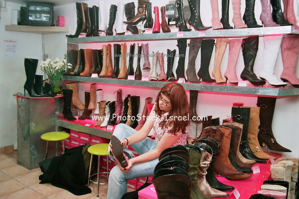 Tel Aviv, Israel, a young woman buying shoes buying shoes in a shoe store