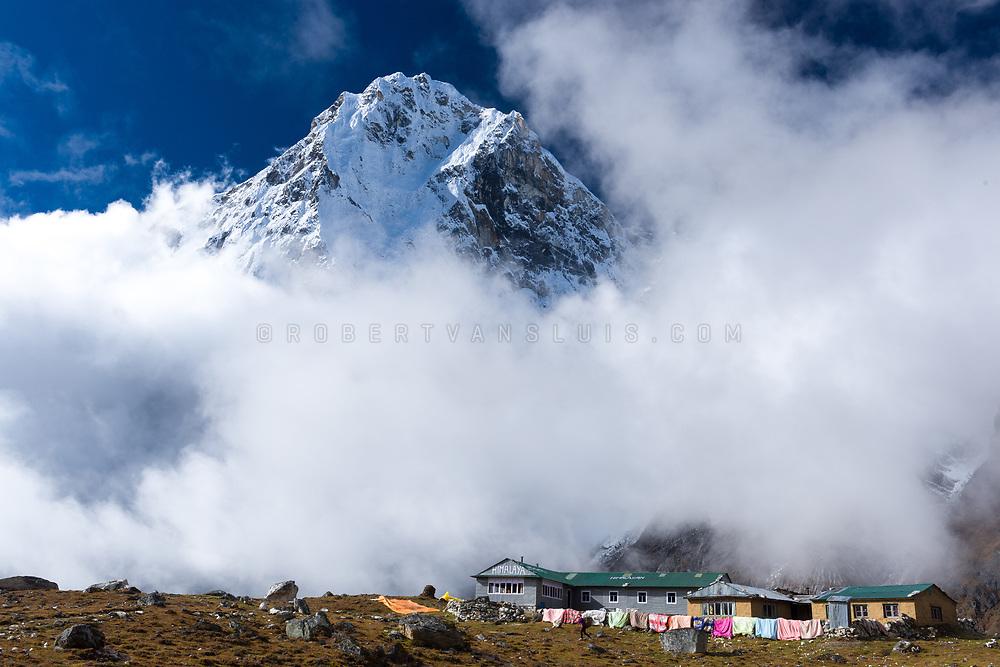 Arakam Tse (6429 m) rises above a trekkers lodge in Dzongla, Nepal Himalaya. Photo © robertvansluis.com