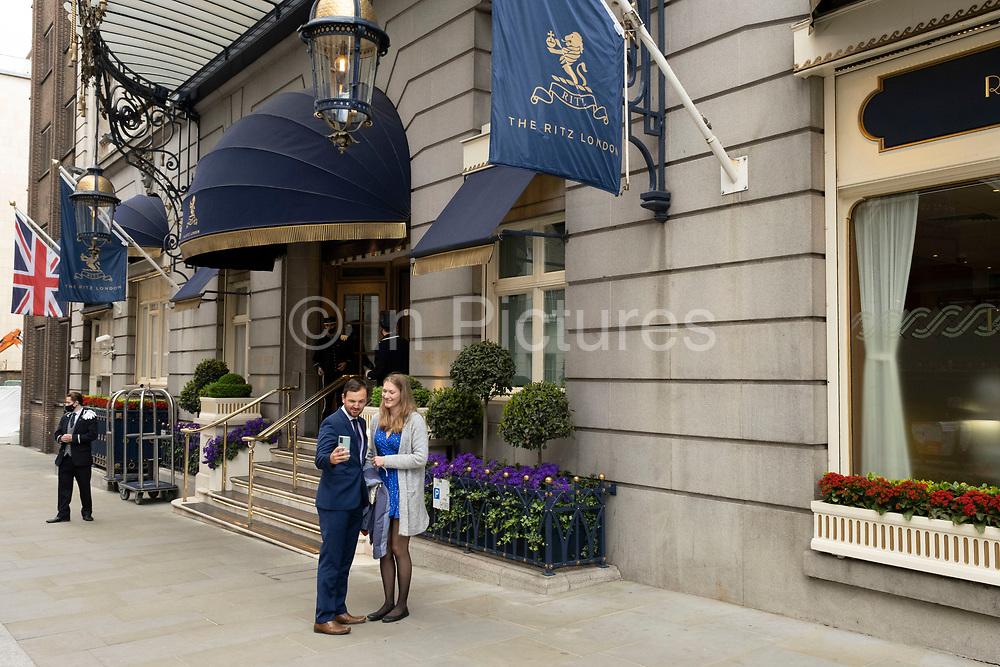 People outside the Ritz Hotel on 25th May 2021 in London, United Kingdom. As the coronavirus lockdown continues its process of easing restrictions, more and more people are coming to the West End as more businesses open.