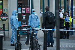 © Licensed to London News Pictures. 29/04/2021. London, UK. Police forensics at the scene at High Road in Willesden Green, North West London, where a man, reported to be in his 40s, has been stabbed to death at a bus stop. Photo credit: Ben Cawthra/LNP