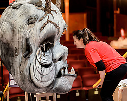 Pictured: Head of Development Kirstie Cusick with a giant foam monster head, one of the items up for auction.<br /> <br /> Glasgow's Citizens Theatre auctioned off some of it's most famous props and costumes, as it prepares for a 19 million GBP refurbishment.<br /> <br /> © Dave Johnston / EEm